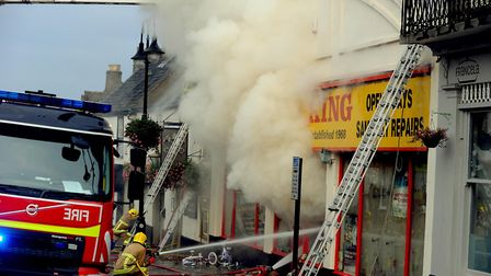 Firefighters tackle the serious fire at the Cycle King shop on Angel Hill in Bury St Edmunds. Pict