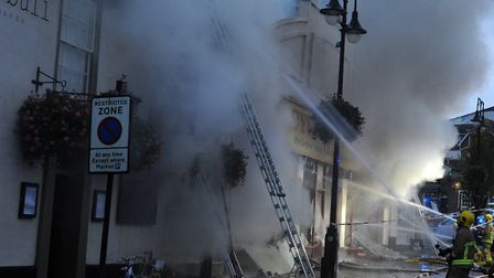 Firefighters tackle the serious fire at the Cycle King shop on Angel Hill in Bury St Edmunds. Pictu