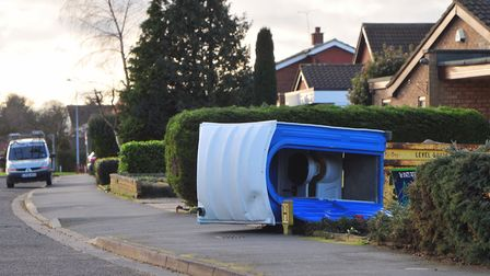 A portaloo in Henley Road lies on its side after it was blown down in high winds overnight. Picture
