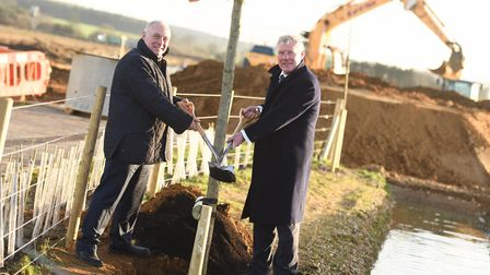 Councillor John Griffiths (right), leader of St Edmundsbury Borough Council planting the first tree