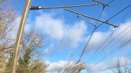 The power of the storm: Overhead power wires and the posts that carry them were brought down between