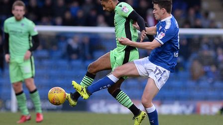 Brandon Comley, under pressure from Chesterfield's Conor Dimaio during the goalless draw in Derbyshi