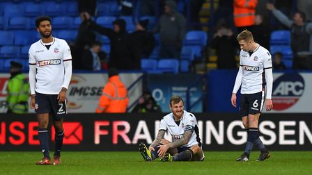 Bolton Wanderers player look dejected after their recent FA Cup defeat to Huddersfield. Photo: PA