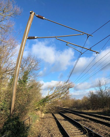 The power of the storm. Overhead power wires and the posts that carry them were brought down between