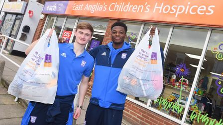 Ipswich Town players help launch EACH charity donation scheme. Left to right, Dominic Iorfa and Call