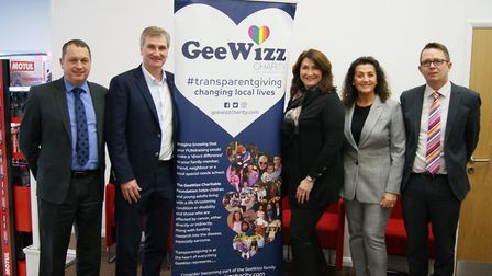 Representatives from John Banks Group with Gina Long from the GeeWizz charity. Picture: JOHN BANKS G