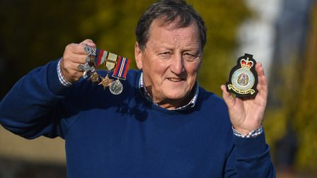 Damian Hearne, with his father's medals. Picture: GREGG BROWN
