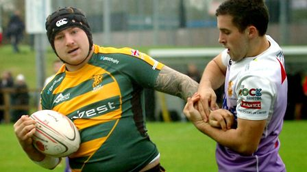 Sam Bixby, left, retaining the ball against Clifton, will again take on the hooker duties for Bury S
