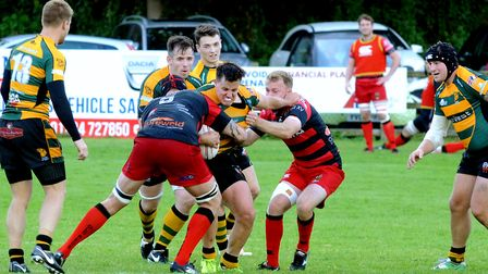 Boyd Rouse, in the thick of the action during Bury's home match against Old Redcliffians from earlie