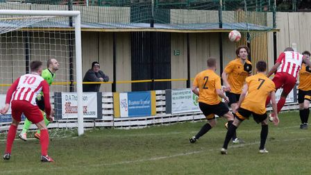 Stow's Anton Clarke (no 11) heads home Dave Cowley's cross to complete his hat-trick in Stow's win a