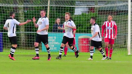 Jordan Palmer (2nd left) celebrates his goal with Haverhill Rovers colleagues. Picture: STAN BASTON