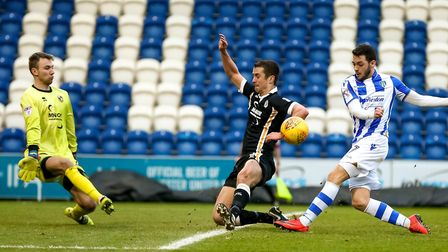 Drey Wright was denied a goal by the combination of defender Danny Pugh and keeper Ryan Boot during