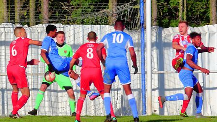 Ipswich Wanderers' match-winner Paulo Coelhio connects with the ball in a crowded penalty area. Pict