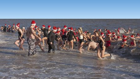 Participants in the annual Aldeburgh Boxing Day Swim. Picture: MIKE SHEPHERD
