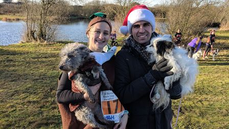 Beth Bell, 20, with her terrier cross Olly and Dane Sayer, 28, with his papillon Tilly at the Bungay