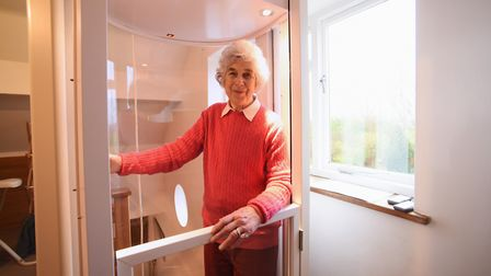 Jane Seppings in her lift arriving on the upper floor of her home at Weston. Picture: DENISE BRADLEY