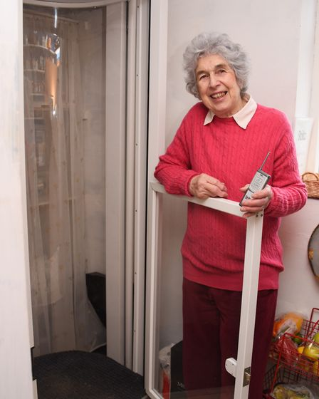 Jane Seppings with her lift which has been installed in the larder of her home at Weston. Picture: D