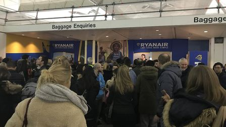 Hundreds of passengers at Stansted Airport had to rebook flights cancelled due to bad weather. Pictu