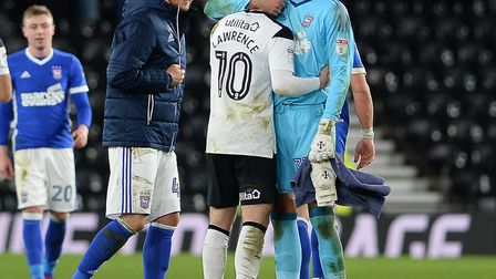 Bartosz Bialkowski gives former team-mate Tom Lawrence a hug after Ipswich's win at Derby. Photo: Pa