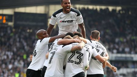 Tom Huddlestone (top) and Derby team-mates celebrate David Nugent's second goal in a recent 3-0 home