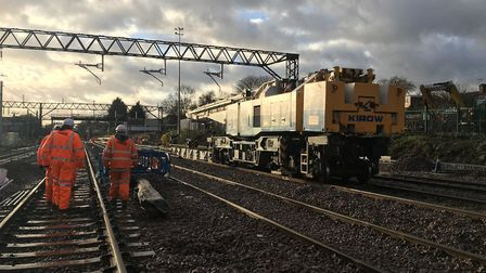 A specialist crane replacing wires at Gidea Park during the Christmas shutdown. Picture: NETWORK RAI
