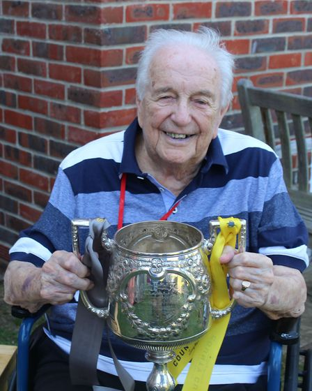 Cyril Garnham had a surprise visitor at his 90th birthday party – the Suffolk Senior Cup
