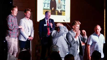 Joey Abbs and Shaun Whiter look on as guests at the Suffolk FA Awards Night in June take part in a g