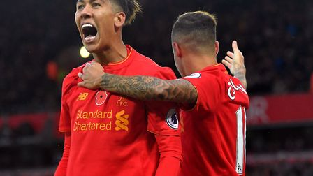 Liverpool's Roberto Firmino celebrates scoring a goal with Philippe Coutinho (right) against Watford