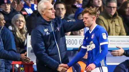 Town manager Mick McCarthy commiserates with Teddy Bishop as he leaves the pitch after rupturing his