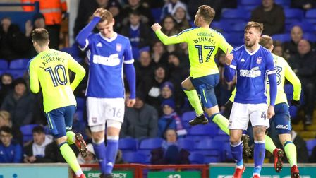 Luke Chambers tries to lift the team as Sam Winnall celebrates his second goal to give the visitors