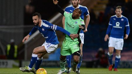Kyel Reid is impeded by Chesterfield skipper Robbie Weir during yesterday's 0-0 draw at Chesterfield