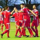 Miles Powell (9) celebrates with Felixstowe team-mates after his equaliser to make it 2-2 against Go