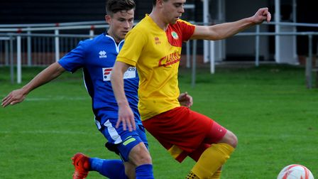 Brantham's Ed Nobbs, left, had a good game for Athletic against Newmarket.