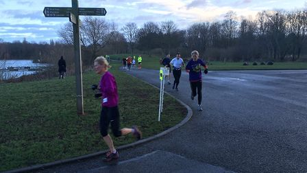 Runners make a turn around Overton lake at last weekend's Peterborough parkrun. Picture: CARL MARSTO