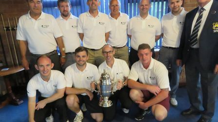 Ufford Park's Tolly Cobbold Cup winners receive their trophy from SGU president Colin Firmin (back r