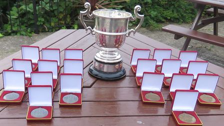 The silver Hambro Cup and trophies for the winning and losing finalists. They have taken the place o