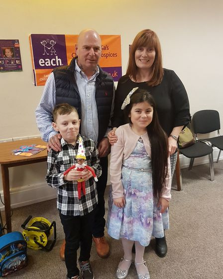 Gorgi Upton, nine, with her dad Chris, her mum Sharon and her eight-year-old brother Alfie. Picture: