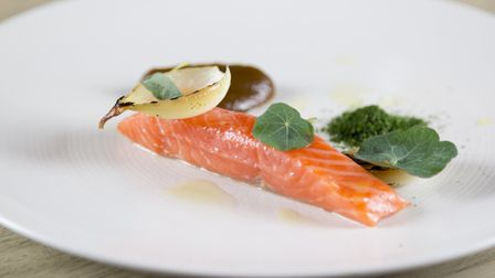 Sea trout with bone marrow and prune puree and kale powder. Picture: Sarah Groves