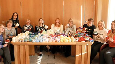 Staff with the knitted baby hats. Picture: FISHER JONES GREENWOOD
