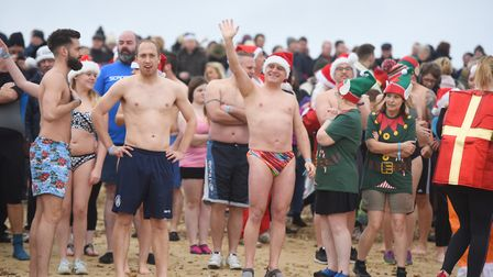 Fundraisers ready themselves for the dip. Picture: GREGG BROWN