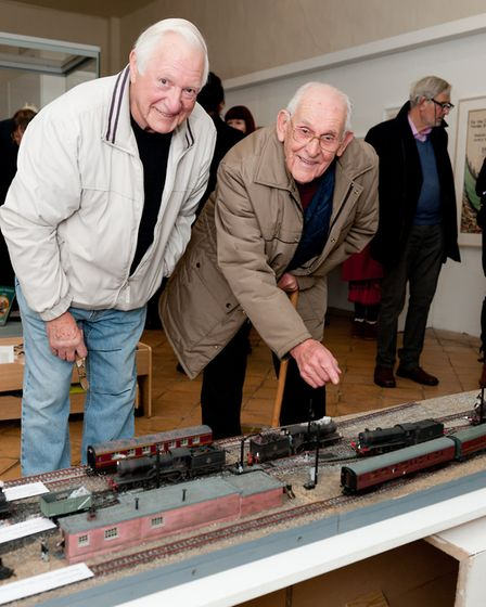 Rodney Mortlock, left, and Dick Youngs with the model Rodney built.