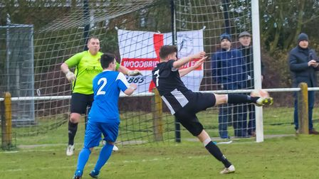 Matt Mackenzie connects with a fine volley to score his second for Woodbridge. Picture: PAUL LEECH