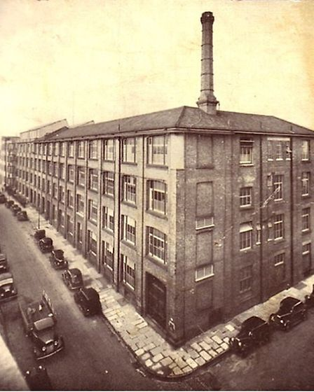This Pretty's Corset Factory shows the junction of Peel Street and Tower Ramparts, with the chimney