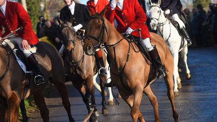 Riders hurry through Hadleigh to begin the annual Boxing Day hunt. Picture: GREGG BROWN