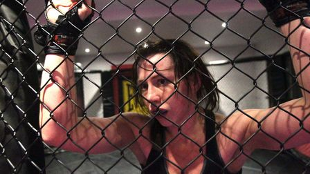Kerry Hughes is entertaining both inside and outside the cage. Picture: STEVE ARGENT
