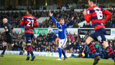 Joe Garner appeals for a handball by Jack Robinson in the 90th minute. Picture: STEVE WALLER