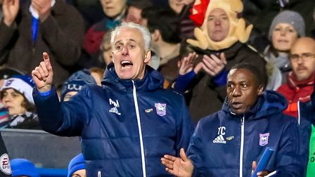 Town manager Mick McCarthy, assistant Terry Connor and a fan with a turkey on his head are pictured