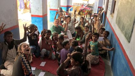Olivia Ranoe-Hall with children in India. Picture: VSO