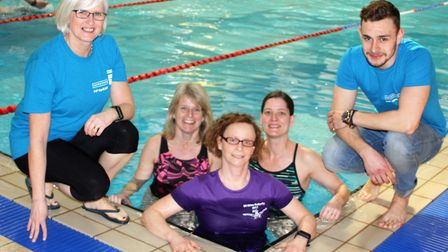 Suffolk swimmer Nikki Hambling, pictured centre, has completed her 50 mile butterfly challenge. Pict