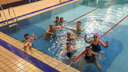 Nikki Hambling, pictured in the pink hat, after completing her 50th mile at Stradbroke pool. Picture